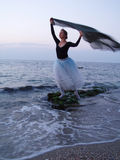 Silhouette of a ballet girl. Silhouette of a girl standing in ballet pose at the sea Stock Photo