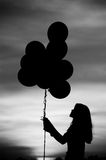 Silhouette balloon girl. Silhouette of girl with balloon royalty free stock photography