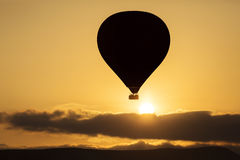 Silhouette of balloon over sunrise in Cappadocia, Turkye Stock Photography