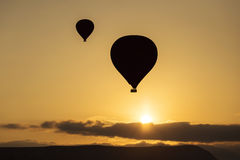 Silhouette of balloon over sunrise in Cappadocia, Turkye Royalty Free Stock Photos