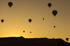 Silhouette of balloons over sunrise in Cappadocia, Turkye Stock Images
