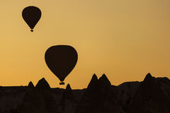 Silhouette of balloons over sunrise in Cappadocia, Turkye Stock Photography