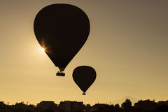 Silhouette of balloons over sunrise in Cappadocia, Turkye Stock Photos