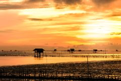 Silhouette of bamboo cottage with morning sunshine in gulf of Thailand Royalty Free Stock Images