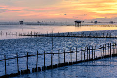 Silhouette of bamboo cottage with morning sunshine in gulf of Thailand Stock Photo