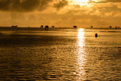 Silhouette of bamboo cottage with morning sunshine in gulf of Thailand Royalty Free Stock Photo