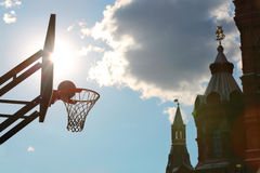Silhouette of a basketball ball in basket against Kremlin. Royalty Free Stock Photography