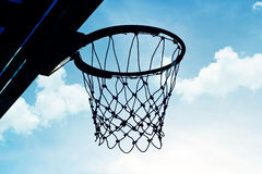 Silhouette basketball hoop outdoors in the cloud and blue sky Royalty Free Stock Photo