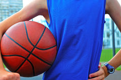 Silhouette of a basketball player outdoor Stock Photos