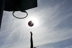 Silhouette of a basketball player scoring Royalty Free Stock Image