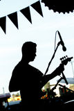 Silhouette of a bass player at a concert royalty free stock photos