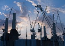 Silhouette of the Battersea Power Station and Construction Cranes stock photos