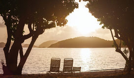 Silhouette of beach chairs Royalty Free Stock Photos