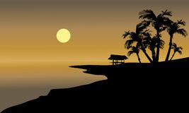 Silhouette of beach and hut Stock Image