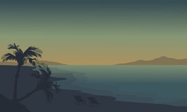 Silhouette of beach at summer holiday with fog. At sunrise Royalty Free Stock Image