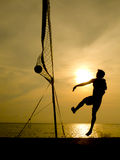 Silhouette of beach volleyball player. At sunset Royalty Free Stock Photos