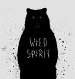 Silhouette of  bear with wild spirit lettering. Vector Stock Images