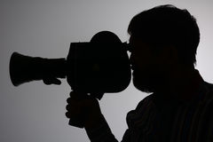 Silhouette bearded Man Movie Camera aside Stock Photo