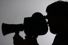 Silhouette bearded Man Movie Camera Stock Image