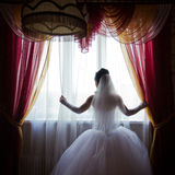 Silhouette of a beautiful bride in wedding dress Royalty Free Stock Photography
