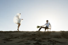 Silhouette of beautiful couple on sand dune Stock Photography