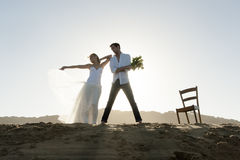 Silhouette of beautiful couple on sand dune Royalty Free Stock Photos
