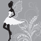 Silhouette of beautiful fairy. Silhouette of young beautiful fairy in white dress Stock Image