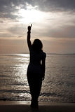 A silhouette of a beautiful girl against the sunset Stock Photography
