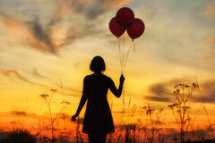 Balloons. Silhouette of a beautiful girl with balloons Royalty Free Stock Photos