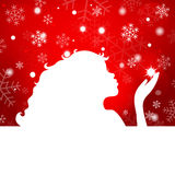 Silhouette of beautiful girl blowing snowflakes on a red backgro Royalty Free Stock Photos