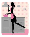 Silhouette of beautiful girl cooking Royalty Free Stock Photography