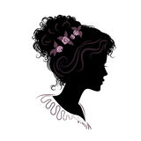 Silhouette of a beautiful girl with hair stacked. vector illustr Stock Photos