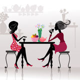 Silhouette beautiful girls in cafes Stock Images