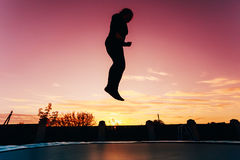 Silhouette Of Beautiful Plus Size Young Woman Girl Jumping On Tr Royalty Free Stock Image