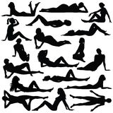 Silhouette of beautiful woman in bikini sitting and laying. Black silhouette of beautiful woman in bikini sitting and laying Stock Images