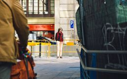 Silhouette of beautiful woman in central Barcelona. Incognito wearing sunglasses stock image
