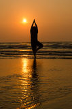 Silhouette of a beautiful Yoga man Stock Images