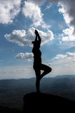 Silhouette of a beautiful Yoga woman.  Stock Photography