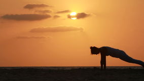 Silhouette of a beautiful Yoga woman stock video footage