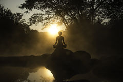Silhouette of a beautiful Yoga woman in the morning Royalty Free Stock Image