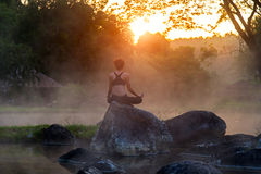 Silhouette of a beautiful Yoga woman in the morning Royalty Free Stock Photography