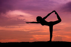 Silhouette of a beautiful Yoga woman Royalty Free Stock Image