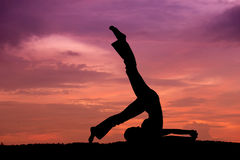 Silhouette of a beautiful Yoga woman Stock Images