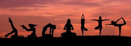 Silhouette of a beautiful Yoga woman stock photo