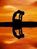 Silhouette of a beautiful Yoga woman royalty free stock photos