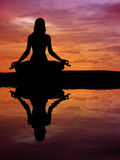 Silhouette of a beautiful Yoga woman Royalty Free Stock Photo