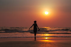 Silhouette of a beautiful young girl on sunset in India, Goa, Ar. Ambol beach Stock Photography