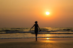 Silhouette of a beautiful young girl on sunset in India, Goa, Ar. Ambol beach Royalty Free Stock Photo