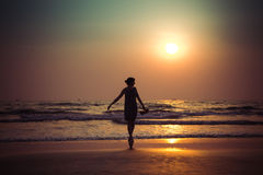 Silhouette of a beautiful young girl on sunset in India, Goa, Ar. Ambol beach Royalty Free Stock Photography