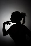 Silhouette of beautiful young woman. Thinking Stock Photo